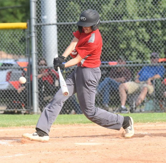 Mountain Home MacLeod's Brycen Benedict connects with a pitch earlier this season.
