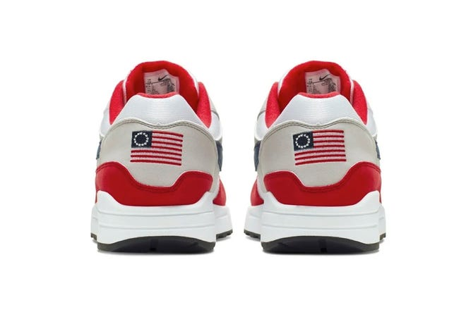 This undated product image obtained by The Associated Press shows Nike Air Max 1 Quick Strike Fourth of July shoes that have a U.S. flag with 13 white stars in a circle on it, known as the Betsy Ross flag.