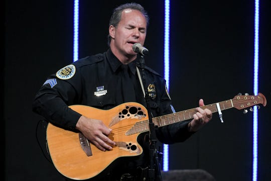 Henry Particelli performs during the memorial service for Officer John Anderson at Cornerstone Church Monday, July 8, 2019, in Nashville, Tenn.