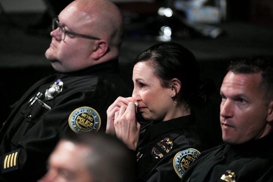 People get emotional during the memorial service for Officer John Anderson at Cornerstone Church Monday, July 8, 2019, in Nashville, Tenn.