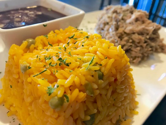 Lunch pork slow roasted and marinated, with yellow rice and beans at Fernandez the Bull Cuban Cafe in North Naples.