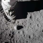 A close-up view of an astronaut's boot and bootprint in the lunar soil,  during the Apollo 11 lunar surface  activity.