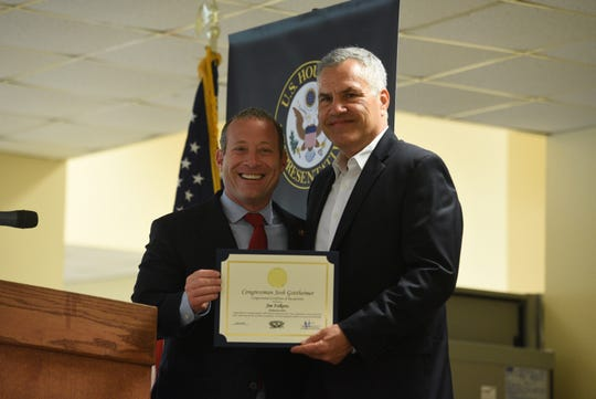 """US Congressman Josh Gottheimer (D-5th district) recognized """"Hometown Heroes,"""" during a ceremony at Felician University in Lodi on July 8, 2019. """"Hometown Hero,"""" Jim Folkerts of Oakland."""
