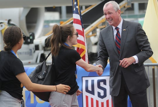 Gov. Phil Murphy greets the World Cup champions at Newark International Airport. Monday, July 8, 2019