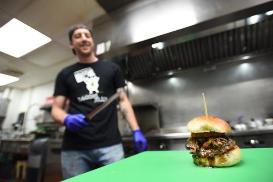 Dan Campeas, owner, works in the kitchen at Stuffed Grass-fed Burgers in Montclair.