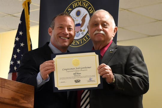 """US Congressman Josh Gottheimer (D-5th district) recognized """"Hometown Heroes,"""" during a ceremony at Felician University in Lodi on July 8, 2019. """"Hometown Hero,"""" Bill Peters."""
