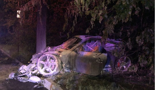 A 2013 Porsche crashed into a utility pole and caught fire after the driver lost control in a curve, Verona police said.