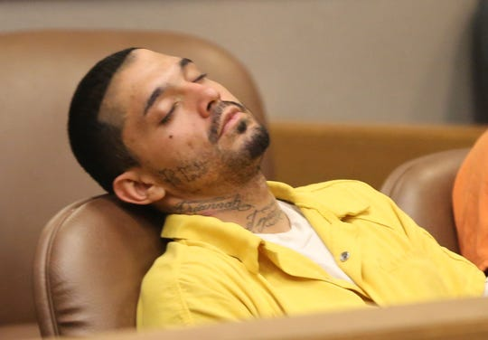 Michael Wood, 25, sleeping in court Wednesday July 3, 2019, waiting for his pre-trial detention hearing, which was ultimately rescheduled for Monday July 8, 2019.