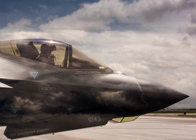An F-35 Lightning II pilot from Hill Air Force Base, Utah, waits to taxi onto the runway June 20, 2019, at Mountain Home Air Force Base, Idaho. This double exposure photo was achieved in camera by combining two perspectives, a photo of the F-35 and photo of the sky, to create a singular image.