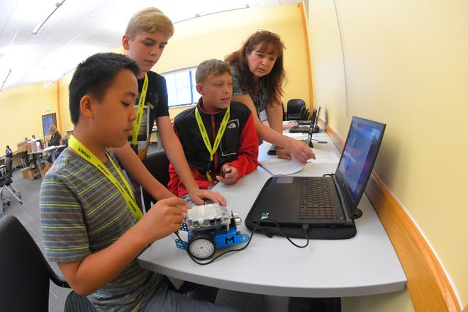 Students write code to program robots with instruction from instructor Patricia Bodley during a LEGACY (Leadership Experience Growing Apprenticeships Committed to Youth) program camp June 26, 2019, at the Freeport Center in Clearfield, Utah. LEGACY is an Air Force program aimed at building interest in science, technology, engineering and math (STEM) through hands-on activities while showing how STEM applies to the world.