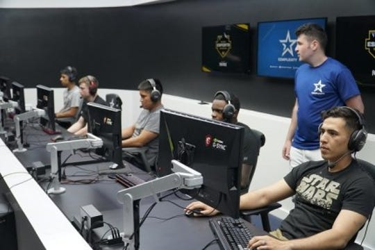 Two weeks after professional gamers visited Fort Bliss to see how Soldiers train and live, the tables were turned when 15 Soldiers visited Complexity Gaming headquarters at the GameStop Performance Center in Frisco, Texas, on June 28 to experience the life of a professional esports gamer.