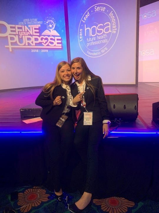Miller and Benson showing off their fourth place finalist pins at the HOSA conference.