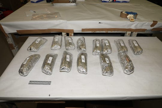 Fourteen foil-wrapped, burrito-shaped packages were found in Ricardo Renteria's Chevrolet Tahoe.