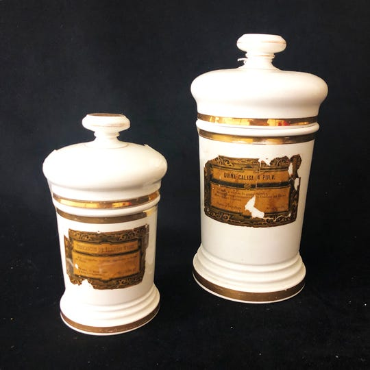 Antique apothecary jars in porcelain have become popular bathroom accessories.