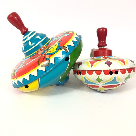 Collecting tin toys like this spinning top is an inexpensive way to get started.