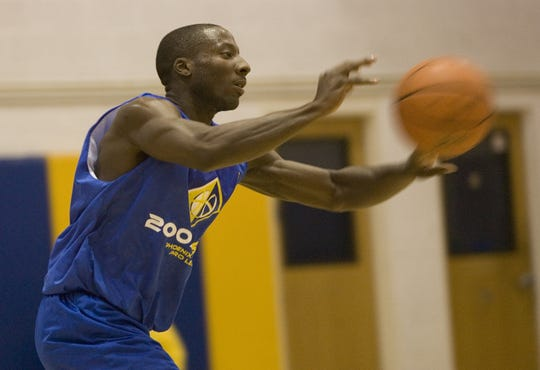 Former ASU player Curtis Millage makes a pass during a game while playing in the Phoenix Summer Pro League at the Phoenix Country Day School gymnasium June 26, 2007.