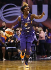 Mercury's Essence Carson (17) calls out to her teammates as she dribbles down the court against the Dream during the first half at Talking Stick Resort Arena in Phoenix, Ariz. on July 7, 2019.