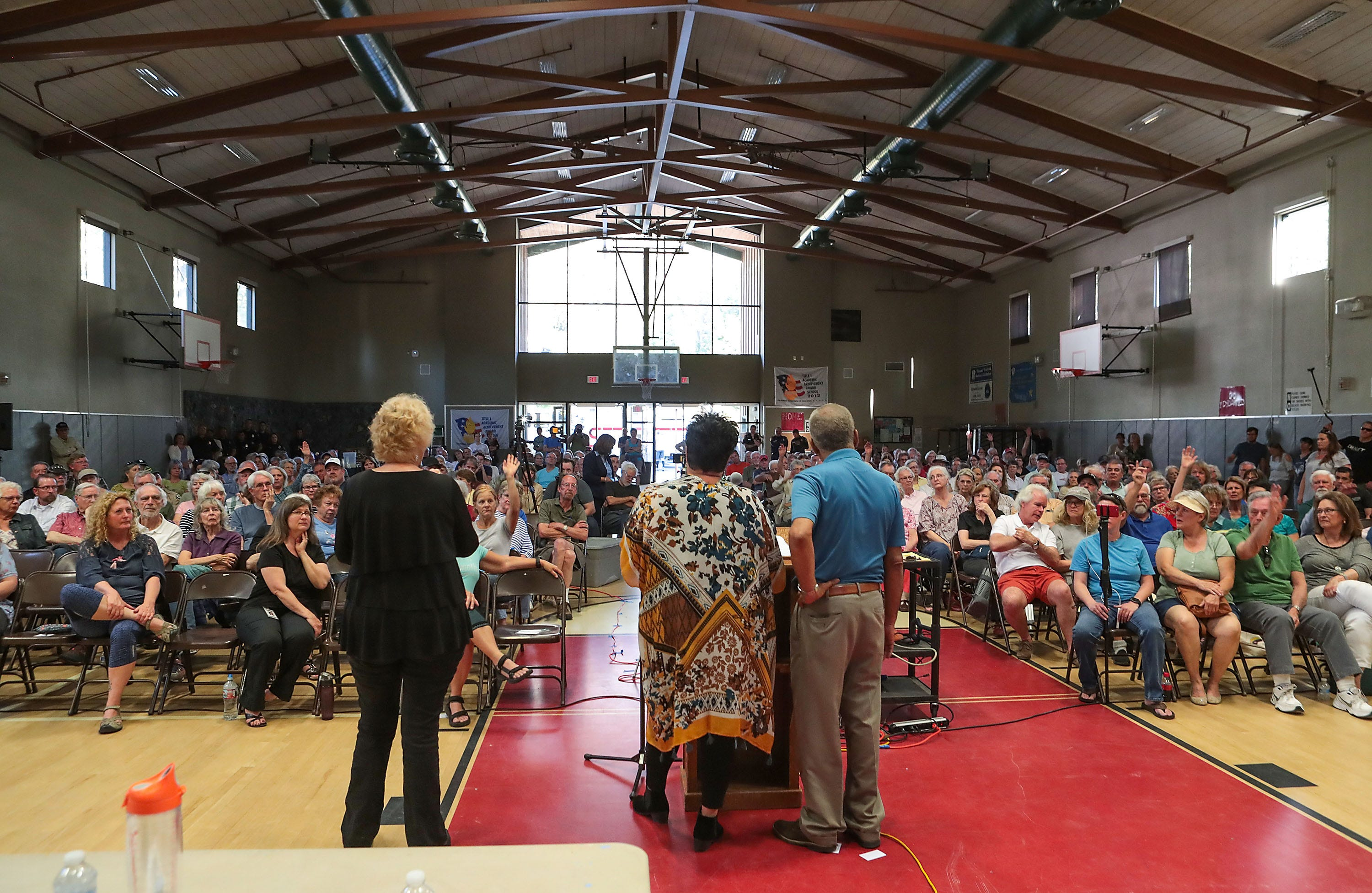Residents of Idyllwild, Calif., and nearby mountain communities gather for a meeting about the progress of the reconstruction of Highway 243 at the Idyllwild School in June 2019. Portions of the road were destroyed by heavy rainfall earlier this year.