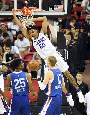 James Palmer Jr. #60 of the Phoenix Suns dunks in front of Andrew White III #25 and Ignas Brazdeikis #17 during the 2019 NBA Summer League at the Thomas & Mack Center on July 7, 2019 in Las Vegas, Nevada.