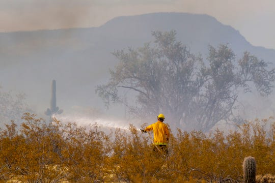 A brushfire erupted Sunday afternoon, July 7, 2019, in north Phoenix, closing streets from Cave Creek Road to Jomax Road and Tatum Road as fire crews from multiple agencies worked on the scene.