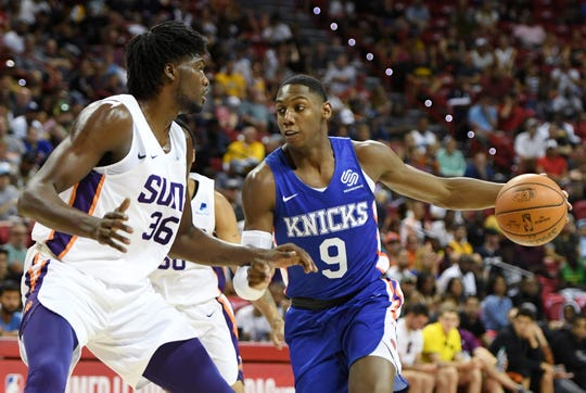RJ Barrett #8 of the New York Knicks drives to the basket against Landry Nnoko #36 of the Phoenix Suns during the 2019 NBA Summer League at the Thomas & Mack Center on July 7, 2019 in Las Vegas, Nevada.