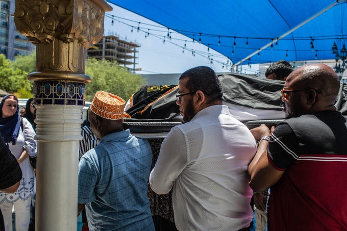 Elijah Al-Amin's body is carried to a hearse following a prayer held at the Islamic Community Center in Tempe on July 8, 2019.