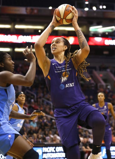 Mercury's Brittney Griner (42) shoots against Dream's Elizabeth Williams (1) during the second half at Talking Stick Resort Arena in Phoenix, Ariz. on July 7, 2019.