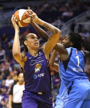 Mercury's Brittney Griner (24) shoots against Dream's Elizabeth Williams (1) during the first half at Talking Stick Resort Arena in Phoenix, Ariz. on July 7, 2019.