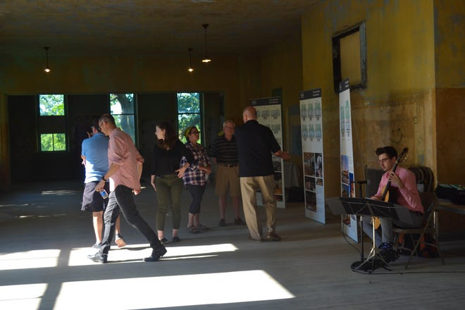 A group of visitors tour Lakeside School to learn about possible renovation plans and view pictorial architectural designs by architecture firm Schooley Caldwell. Several more tours are scheduled through Aug. 12.