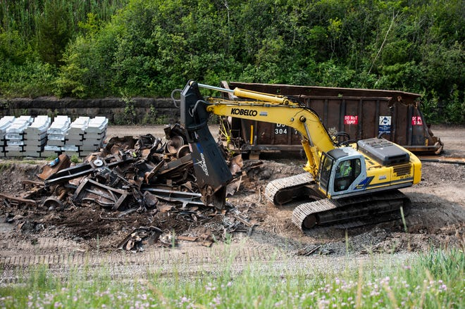 Construction crews work Monday morning, July 8, 2019, on a pile of scrap from the June 28 train derailment in the international tunnel to Sarnia.
