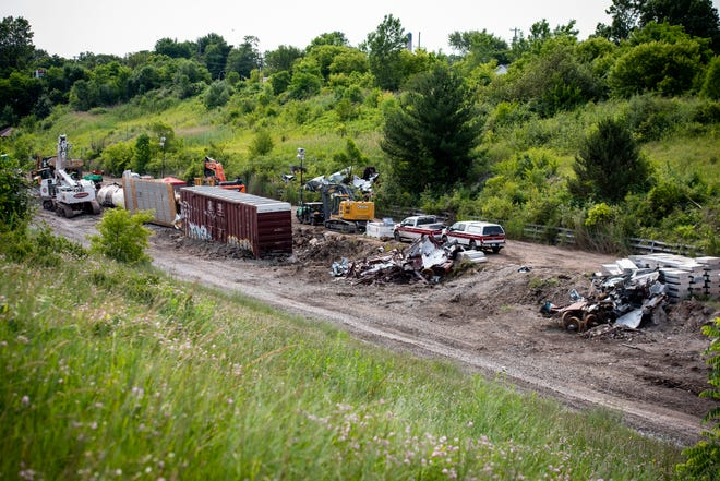 Crews continue working Monday morning, July 8, 2019, to remove cars damaged in the June 28 train derailment in the international tunnel to Sarnia.