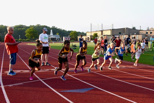 Young runners take part in the Hudson Road Runners Club (MHRRC) Track Series at Franklin D. Roosevelt High School's track July 5.