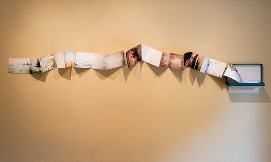 Anna Leigh Clem created an accordion fold book that is displayed across the gallery wall.
