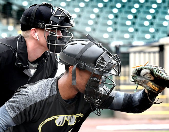Atlantic League umpire Brian deBrauwere wears an earbud behind Revolution catcher James Skelton during a demonstration of the automated ball-strike system at PeopleBank Stadium Monday, July 8, 2019. The system, sanctioned by Major League Baseball, will make its official debut at the 2019 Atlantic League All-Star Game at the park.Bill Kalina photo