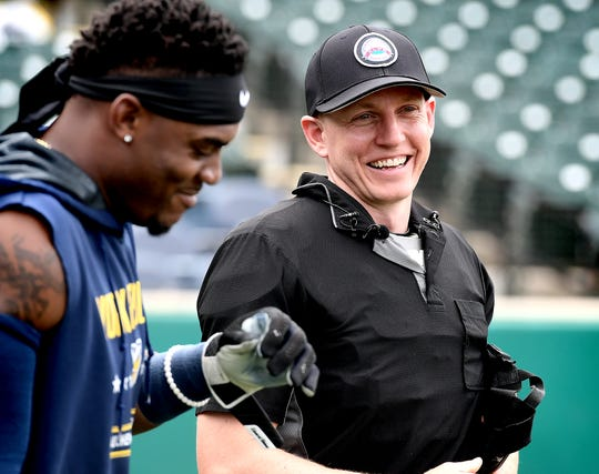 Atlantic League umpire Brian deBrauwere jokes with Revolution batter Telvin Nash during a demonstration of the automated ball-strike system at PeopleBank Stadium Monday, July 8, 2019. The system, sanctioned by Major League Baseball, will make its official debut at the 2019 Atlantic L eague All-Star Game at the park. Bill Kalina photo