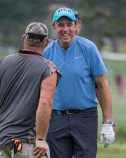 Kevin Nealon jokes with Larry the Cable Guy during the American Century Championship at Edgewood Tahoe Golf Course on July 13, 2017.