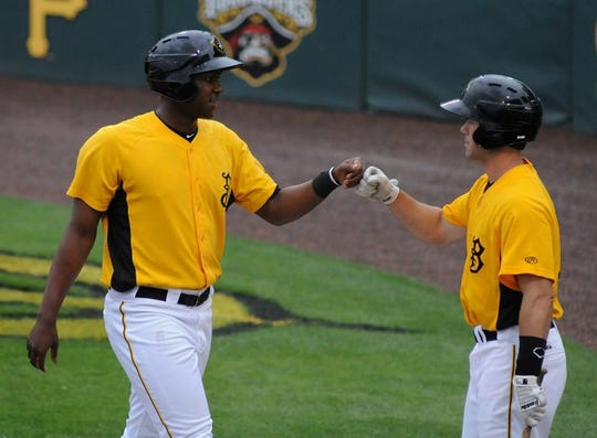 Pittsburgh Pirates first baseman Josh Bell, left, and Hilton native Jon Schwind were teammates in the Pirates' minor league system. Schwind will serve as Bell's pitcher in tonight's Major League Home Run Derby in Cleveland.