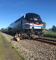 A westbound Amtrak train struck a unoccupied car left on the tracks in Savannah, Wayne County, on July 7, 2019.