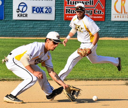 Colt 45s third baseman Julian Kodama scoops up a first-inning grounder as shortstop Brendan Roop hustles to back up the play Sunday night, July 7, 2019, at Tiger Field in Redding.