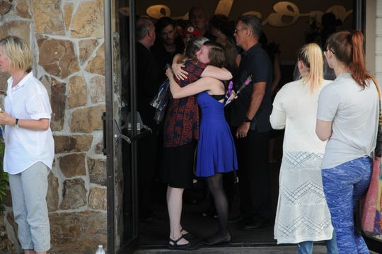 Nyla Bales, mother of Karissa Fretwell, hugs an attendee at a memorial service for Karissa and her 3-year-old son, William, on July 7, 2019.
