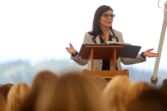 Meg Crofton, the former president of Walt Disney Parks and Resorts, U.S. and France, speaks during the Women in Wine conference at Willamette Valley Vineyards near Salem on July 8, 2019.