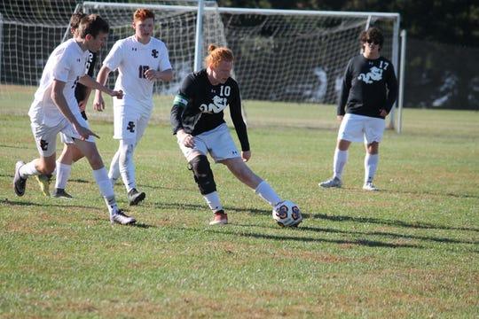 The Salisbury School midfielder Max Sieg dribbles the ball against Salisbury Christian.