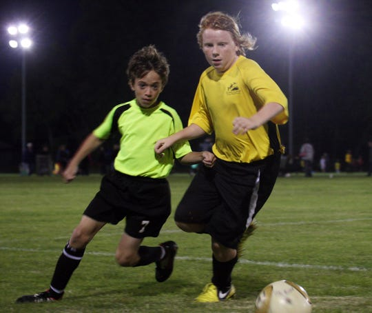 Parks and Recreation Salisbury Fruitland's Lucas Miller, 11, and United's Max Sieg, 11 contend for the ball during the game at Henry Parker Athletic Complex in Salisbury.