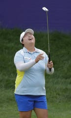 Shanshan Feng of China reacts after making a birdie putt on the final hole to win the Thornberry Creek LPGA Classic on Sunday in Hobart.