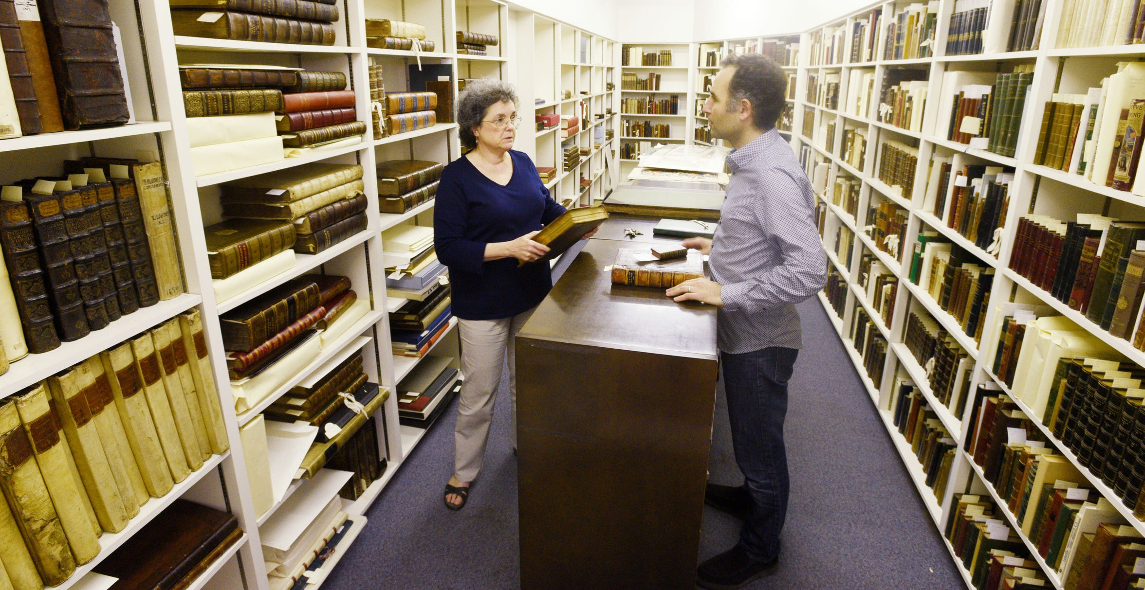 The rare book collection at Noel Memorial Library's Director Martha Lawler and Curator Alexander Mikaberidze inside the vault.