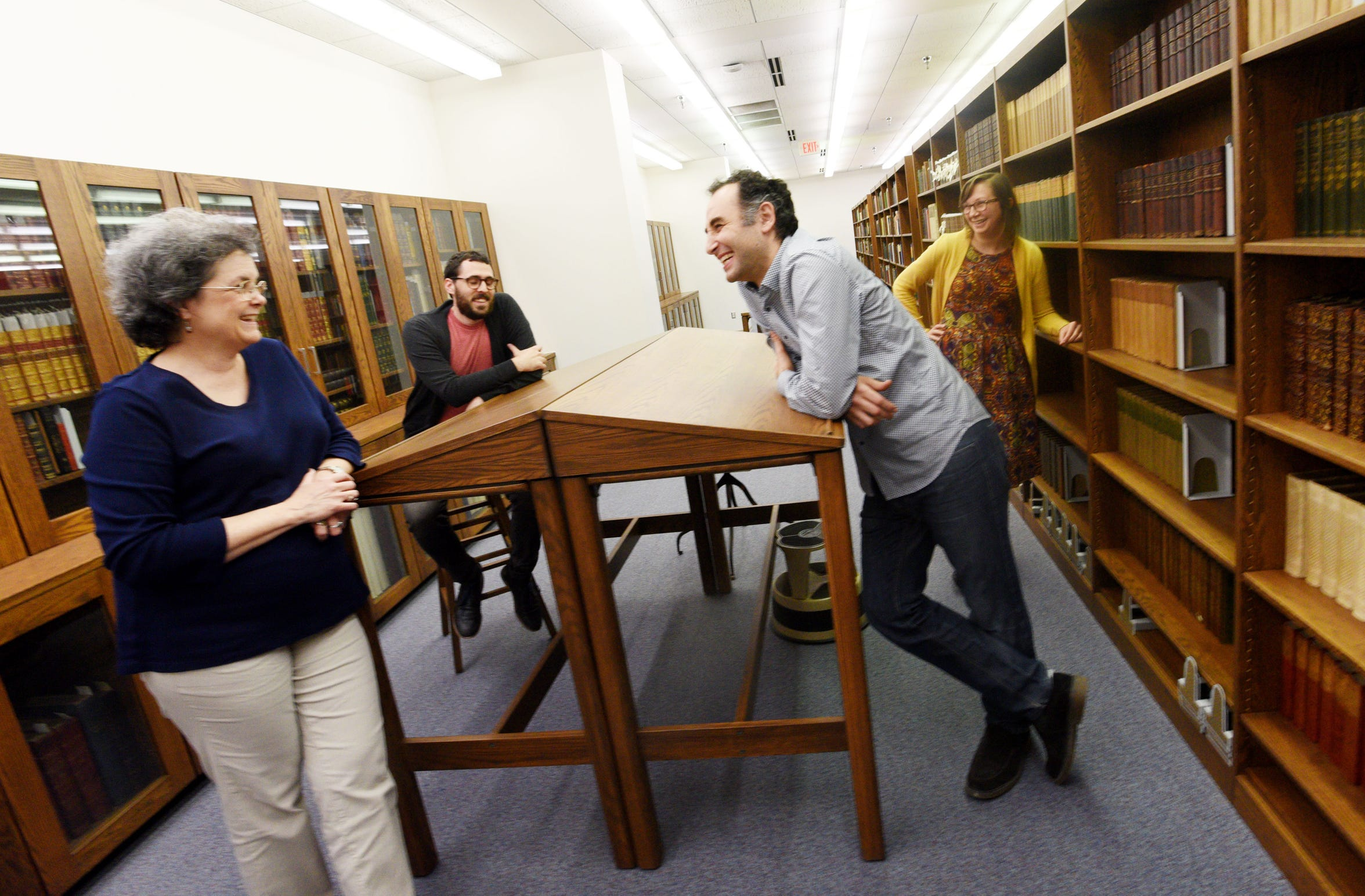 Tthe rare book collection at Noel Memorial Library's staff includes Director Martha Lawler (left), Curator Alexander Mikaberidze (right), and Cataloguers Andrea Schuba and Tyler Cunningham.
