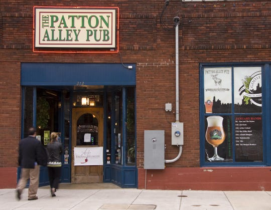 Patrons enter downtown Springfield's Patton Alley Pub in 2009 for a charity benefit.