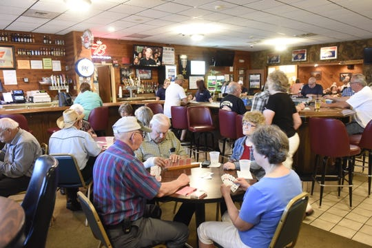 Members of the Waite Park American Legion Post 428 play cards on Tuesday, July 2, 2019.