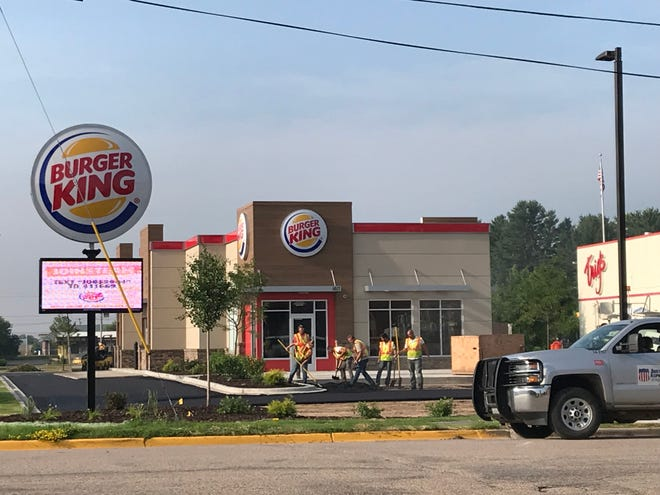 Crews finish the parking lot at the new Burger King, 1617 Scholfield Ave. in Stevens Point.