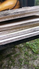 The siding is shown to be originally manufactured by Cemplank, now owned by the James Hardie company.